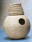 handmade Clay Udu.. The udu is a plosive aerophone (in this case implosive) and an idiophone of the Igbo of Nigeria. Actually being a water jug with an additional hole, it was played by Igbo women for ceremonial uses. Usually the udu is made of clay. The instrument is played by hand. The player produces a bass sound by quickly hitting the big hole. There are many ways that the pitches can be changed, depending on how the hand above the small upper hole is positioned. Furthermore, the whole corpus can be played by fingers. Today it is widely used by percussionists in different music styles.