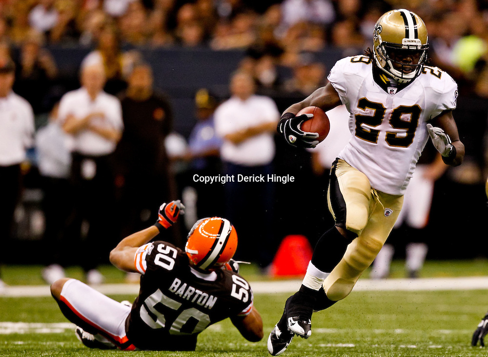 Oct 24, 2010; New Orleans, LA, USA; New Orleans Saints running back Chris Ivory (29) runs away from Cleveland Browns linebacker Eric Barton (50) during the first half at the Louisiana Superdome. Mandatory Credit: Derick E. Hingle