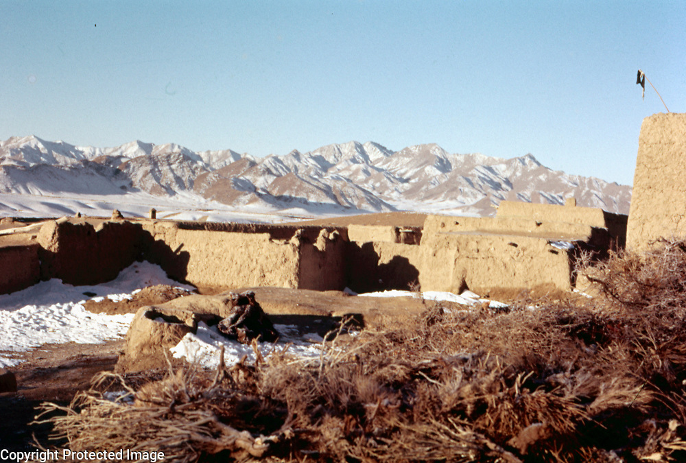 9 January 1963<br /> Kabul. Taraki; looking N. LD Super houses; range of mts. behind; wall of Qala right ND. Mountains and fields covered by a little snow in background.