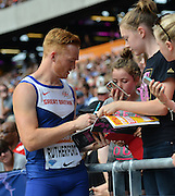 Greg Rutherford signing autographs during the Sainsbury's Anniversary Games at the Queen Elizabeth II Olympic Park, London, United Kingdom on 25 July 2015. Photo by Mark Davies.