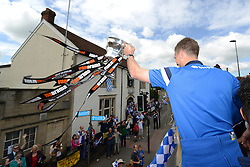 Bristol Rovers' Lee Mansell shows off the Vanarama conference play-off semi-final trophy to fans - Photo mandatory by-line: Dougie Allward/JMP - Mobile: 07966 386802 - 25/05/2015 - SPORT - Football - Bristol - Bristol Rovers Bus Tour