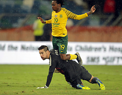 20112018 (Durban)<br /> A goalscorer Percy Tau face the Paraguay goalkeeper Silva during a mactch were Bafana Bafana and Paraguay have drawn 1-1 in the Nelson Mandela Challenge match played at Moses Mabhida Stadium in Durban on Tuesday evening.<br /> Picture: Motshwari Mofokeng/African News Agency (ANA)