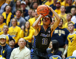 Nov 9, 2018; Morgantown, WV, USA; Buffalo Bulls guard Ronaldo Segu (10) shoots a three pointer during the first half against the West Virginia Mountaineers at WVU Coliseum. Mandatory Credit: Ben Queen-USA TODAY Sports
