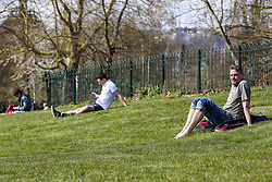 © Licensed to London News Pictures. 04/04/2020. London, UK. Members of the public enjoy the sunshine in Finsbury Park, north London during coronavirus lockdown. According to the Met Office, temperature in London is likely to reach 20 degrees this weekend. The Government has ordered that people go out only for food and health reasons or for work, and keep 2 meters away from other people at all times to slow the spread of the virus and reduce pressure on the NHS. Photo credit: Dinendra Haria/LNP