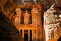 Petra is Jordan's most visited tourist attraction. al-Siq is the main entrance to the ancient city. Al Khazneh, The Treasury, seen from the end of the gorge.