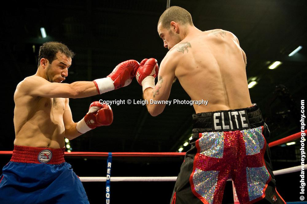 Rick Godding (black shorts) defeats Youssef Al Hamidi at the Bolton Arena, Bolton, UK on 23rd September 2009. Frank Maloney Promotions. photo credit © Leigh Dawney
