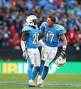 LONDON, ENGLAND - OCTOBER 21: defensive back Desmond King (20) of The Chargers and quarterback Philip Rivers (17) celebrate winning the NFL game between Tennessee Titans and Los Angeles Chargers at Wembley Stadium on October 21, 2018 in London, United Kingdom. (Photo by Mitchell Gunn/Pro Lens Photo Agency) *** Local Caption *** Desmond King; Philip Rivers