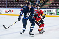 PENTICTON, CANADA - SEPTEMBER 16: Dennis Kravchenko #96 of Calgary Flames checks Axel Blomqvist #65 of Winnipeg Jets on September 16, 2016 at the South Okanagan Event Centre in Penticton, British Columbia, Canada.  (Photo by Marissa Baecker/Shoot the Breeze)  *** Local Caption *** Dennis Kravchenko; Axel Blomqvist;