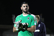 AFC Wimbledon goalkeeper Tom King (1) clapping and walking off pitch during the EFL Carabao Cup 2nd round match between AFC Wimbledon and West Ham United at the Cherry Red Records Stadium, Kingston, England on 28 August 2018.