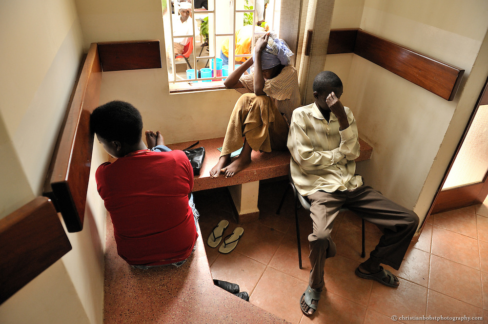 """Clients waiting at the indoor waiting-area of the TASO Service Center  in Kampala. Once clients are registered, all TASO services are free of charge. TASO runs 11 service centers spread in Uganda, with now 22 """"mini-TASOs"""" and Community Based organisations in other parts of the country that are outside TASO's catchment area of 75Km from the nearest service center."""