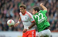 FUSSBALL   1. BUNDESLIGA  SAISON 2012/2013   6. Spieltag   SV Werder Bremen - FC Bayern Muenchen          29.09.2012 Mario Mandzukic (li, FC Bayern Muenchen) gegen Sokratis Papastathopoulos (re, SV Werder Bremen)