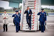 US President Barack Obama jumps the last steps as he descents from the Air Force One at the JFK Airport in New York, on a visit to attend one of many fundraisers.