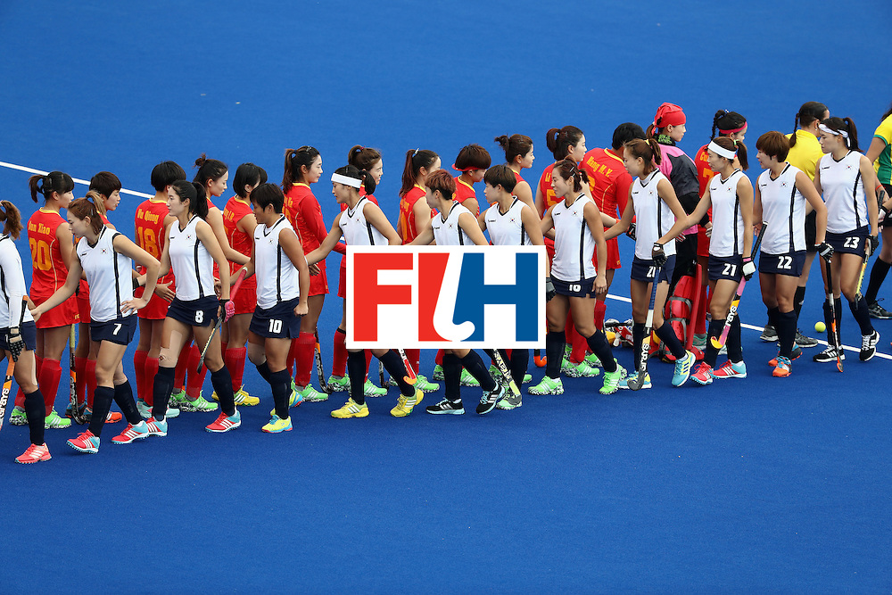 RIO DE JANEIRO, BRAZIL - AUGUST 12:  Team China shakes hands with Team Korea during a Women's Preliminary Pool A match on Day 7 of the Rio 2016 Olympic Games at the Olympic Hockey Centre on August 12, 2016 in Rio de Janeiro, Brazil.  (Photo by Sean Haffey/Getty Images)