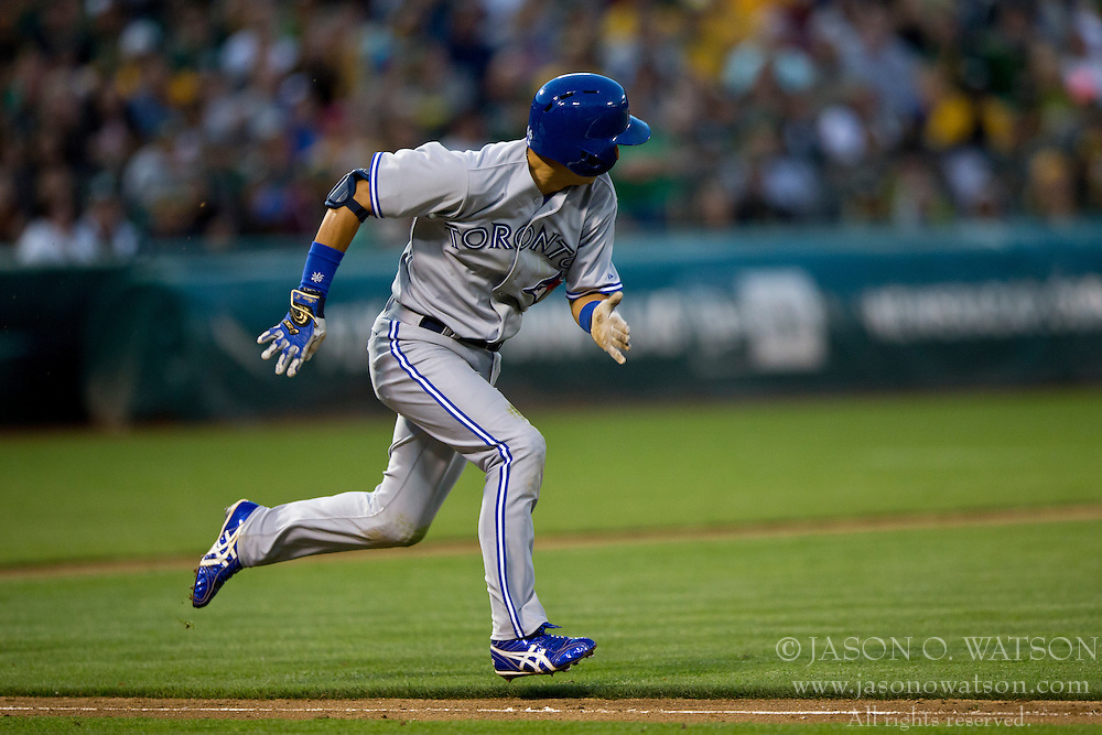 OAKLAND, CA - JULY 05:  Munenori Kawasaki #66 of the Toronto Blue Jays runs to first base after hitting a sacrifice bunt against the Oakland Athletics during the fifth inning at O.co Coliseum on July 5, 2014 in Oakland, California. The Oakland Athletics defeated the Toronto Blue Jays 5-1.  (Photo by Jason O. Watson/Getty Images) *** Local Caption *** Munenori Kawasaki