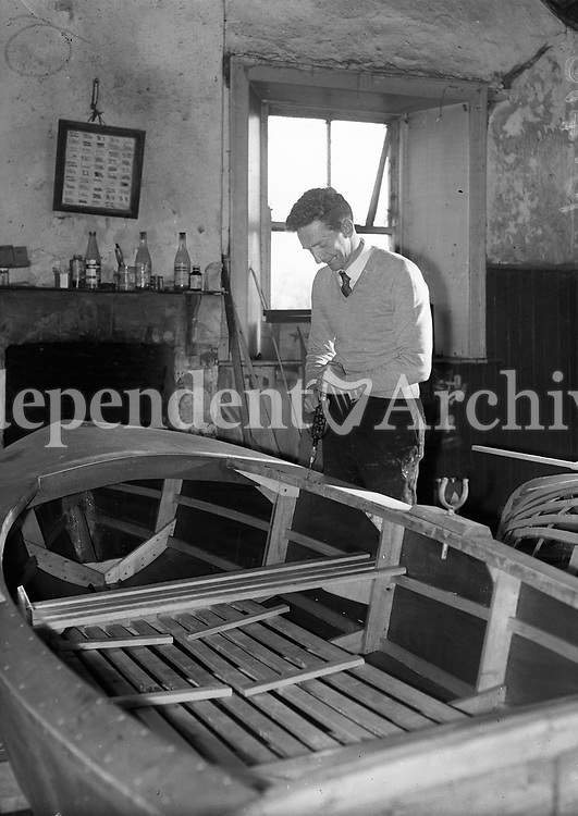 R3177<br /> A man In Donegal working on his boat, July 19 1962.<br /> (Part of the Independent Ireland Newspapers/NLI Collection)