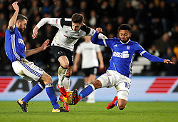 Derby County's Tom Lawrence has his shot blocked by Ipswich Town's Cole Skuse (left) and Grant Ward (right)