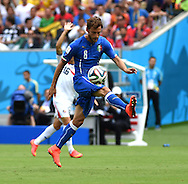 Claudio Marchisio of Italy on the attack during the 2014 FIFA World Cup match at Itaipava Arena Pernambuco, Recife metropolitan area<br /> Picture by Stefano Gnech/Focus Images Ltd +39 333 1641678<br /> 20/06/2014