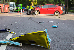 London, July 7th 2017. Emergency services attend a collision between a red Toyota Prius and an ambulance on Park Lane at the intersection of Upper Grosvenor Street. There are no reported injuries, but the ambulance was carrying a patient at the time of the collision, which has closed down all but one southbound lane on Park Lane, with surrounding streets closed to traffic. PICTURED: Bits of wreckage strewn across the road.