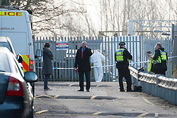 © Licensed to London News Pictures. 24/01/2014. Shenfield, Essex, UK. Police at the scene. Shortly before 6.00am today, 14th January 2014, a 44 year old man was shot in the leg at Shenfield Station, near Brentwood. The assailant fled the scene leaving his car. Photo credit : Simon Ford/LNP