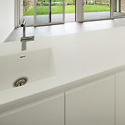 Interior, modern domestic kitchen, white counter top