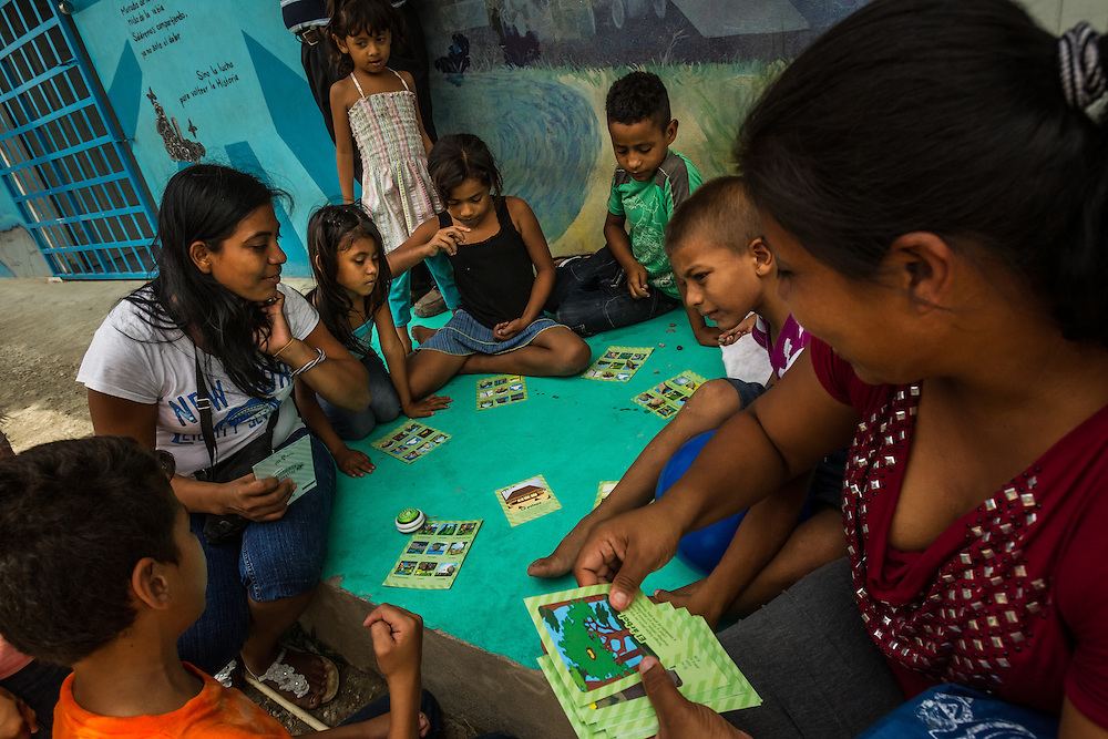 TENOSIQUE, MEXICO - MAY 30, 2014:  Children play bingo at the 72 migrant shelter in Tenosique, where  Catholic priests and other volunteers provide mats for migrants to sleep on, second-hand clothes, meals, basic medical treatment, and help applying for immigration visas and refugee status to people traveling north. The shelter, which traditionally has been visited by men between the ages of 15-35, has been overrun by women and children in recent months, more than double the amount -- consequential of a recent boom of minors headed to the United States from Central America. PHOTO: Meridith Kohut for The New York Times