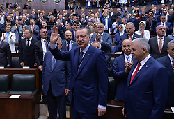June 13, 2017 - Ankara, Türkiye - Turkish President and Chairman of the Justice and Development Party (AK Party) Recep Tayyip Erdogan (C) and Turkish Prime Minister Binali Yildirim (R) attend an AK Party's group meeting at the Grand National Assembly of Turkey (TBMM) in Ankara, on June 13, 2017. (Credit Image: © Depo Photos via ZUMA Wire)