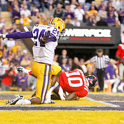 November 17, 2012; Baton Rouge, LA, USA; LSU Tigers cornerback Tharold Simon (24) celebrates after breaking up a pass to Ole Miss Rebels wide receiver Vince Sanders (10) during the second half of a game at Tiger Stadium. LSU defeated Ole Miss 41-35. Mandatory Credit: Derick E. Hingle-US PRESSWIRE