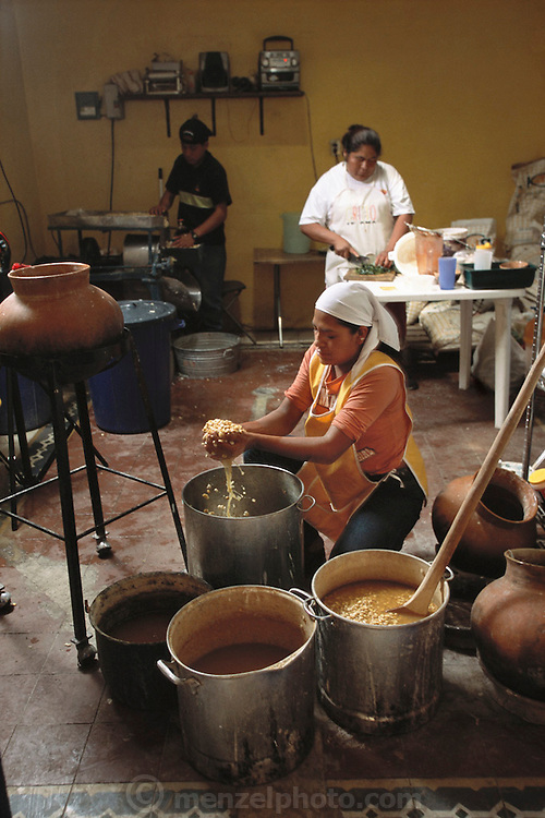 "The Itanoni Tortilleria (""Gourmet Tortillas"") in Oaxaca, Mexico sells handmade tortillas from native corn that it contracts local growers to produce. In the back room, workers wash dried corn after cooking it. It is then ground into a moist flour that is pressed into tortillas and cooked on clay oven tops, called ""comals""."