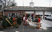 A Christmas tree sale at the Sandy Hook Volunteer Fire Department, Saturday, Dec. 2, 2017, in Newtown, Conn. Twenty six copper stars adorn the roof of the firehouse in honor of the victims.  The firehouse was the staging area for children to be reunited with their families and where families were told their children had been killed. <br /> (Jessica Hill for the New York Times)