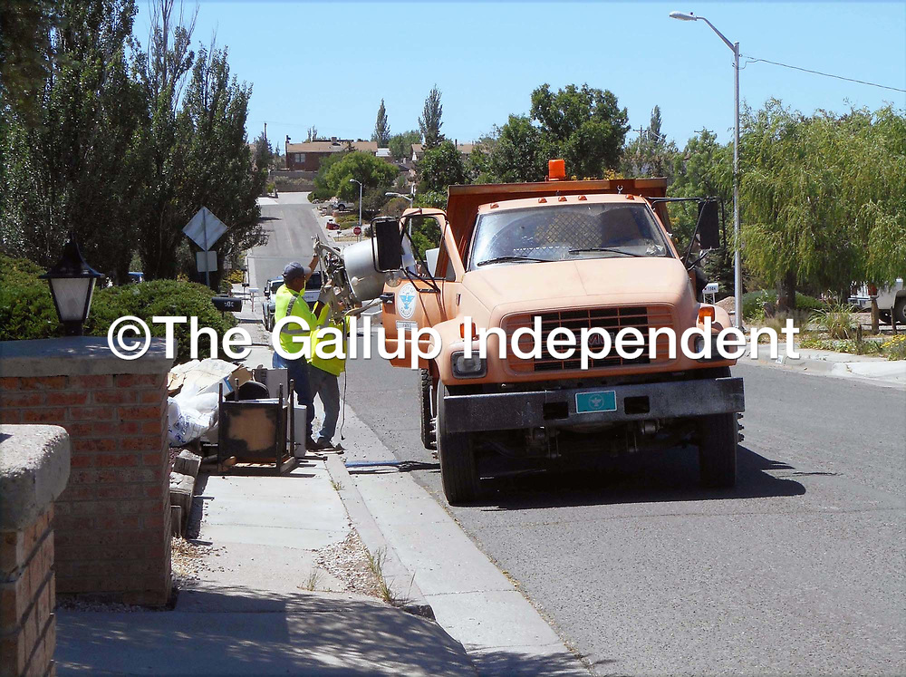 Gallup sanitation crews pick up trash during the city's 8th annual community cleanup Saturday. This was the second cleaunup day of 2018 with pick ups set for June 23 in the southeast section of the city; July 7 for the north side;  July 21 for the southwest section of the city and Aug. 4 for the west side of the city.