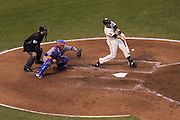 San Francisco Giants designated hitter Buster Posey (28) makes contact with a ball for a single against the New York Mets in the ninth inning at AT&T Park in San Francisco, Calif., on August 21, 2016. (Stan Olszewski/Special to S.F. Examiner)