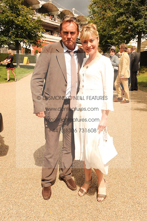 PHILIP GLENISTER and BETH GODDARD at the third day of the 2010 Glorious Goodwood racing festival at Goodwood Racecourse, Chichester, West Sussex on 29th July 2010.