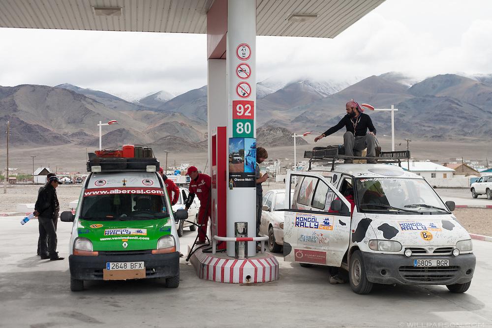 Spanish Mongol Rally teams get gas in Bayan-Ölgii Province, Mongolia, Aug. 15, 2009. One team had started in Spain and had driven through Turkey, Iran, Turkmenistan, Tajikistan, Kyrgyzstan, Kazakhstan and Russia.