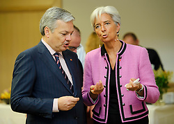 Didier Reynders, Belgium's finance minister, left, speaks with Christine Lagarde, France's finance minister, during the Eurogroup finance ministers meeting in Brussels, Thursday, Sept. 30, 2010. (Photo © Jock Fistick)