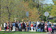 Congregation members gather outside in front of the church after a shooting that left 27-year-old Robert Braxton dead and man that fired the shot being interviewed and cooperating with the police investigation Sunday April 24, 2016 at Keystone Fellowship Church in Montgomery Township, Pennsylvania. (Photo by William Thomas Cain)
