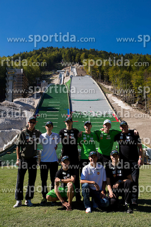 Ski jumpers (L-R): Jure Sinkovec, Jaka Hvala, Robert Kranjec, Nejc Dezman, Dejan Judez, Jernej Damjan, Mitja Meznar, Jurij Tepes and coach Goran Janus at media day of Slovenian Ski jumping team during construction of two new ski jumping hills HS 135 and HS 105, on September 18, 2012 in Planica, Slovenia. (Photo By Vid Ponikvar / Sportida)