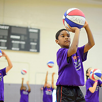 070314       Cayla Nimmo<br /> <br /> Zavier Lloyd practices his shooting skills at basketball camp hosted by Miyamura High School in Gallup Thursday morning.