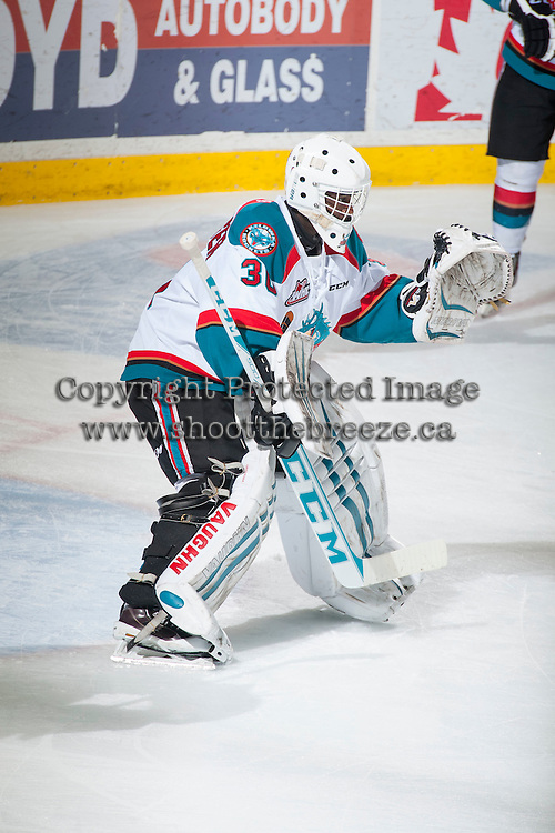 KELOWNA, CANADA - FEBRUARY 9: Michael Herringer #30 of Kelowna Rockets warms up against the Prince George Cougars on February 9, 2015 at Prospera Place in Kelowna, British Columbia, Canada.  (Photo by Marissa Baecker/Shoot the Breeze)  *** Local Caption *** Michael Herringer;