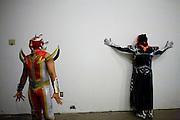 Lucha Libre AAA wrestlers Laredo Kid, left, La Parka, right, wait backstage in Sacramento, CA March 28, 2009.