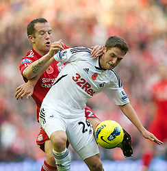 05.11.2011, Anfield Stadion, Liverpool, ENG, Premier League, FC Liverpool vs Swansea City, im Bild Liverpool's Charlie Adam in action against Swansea City's Joe Allen  // during the premier league match between FC Liverpool vs Swansea City at Anfield Stadium, Liverpool, EnG on 05/11/2011. EXPA Pictures © 2011, PhotoCredit: EXPA/ Propaganda Photo/ David Rawcliff +++++ ATTENTION - OUT OF ENGLAND/GBR+++++