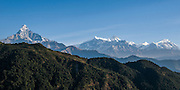 Nepal, Machapuchare the Fishtail Mountain 6,993 m (22,943 ft), is on the left, Annapurna II, and Annapurna IV.
