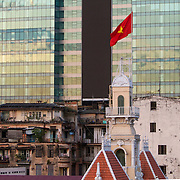 Officially known as the Ho Chi Minh City People's Committee Building, the Saigon Town Hall. Built by the French in 1908 it was first known as the Hotel de Ville.  Ho Chi Minh City ( Th&agrave;nh phố Hồ Ch&iacute; Minh ),  formerly named Saigon is the largest city in Vietnam with a population reaching 10 million. Ho Chi Minh City is a contrast of  French colonial, traditional and modern architecture. <br /> Photography by Jose More