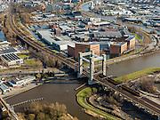 Nederland, Zuid-Holland, Gouda, 20-02-2012;.Zicht op Gouda in oostelijke richting, helemaal rechts de Goudkade, het spoor loopt over de Gouwe, via de viersporige hefbrug (de derde Gouwespoorbrug of Hoge Gouwebrug) View on the city of Gouda eastwards, railway crossing the river Gouwe..luchtfoto (toeslag), aerial photo (additional fee required).copyright foto/photo Siebe Swart