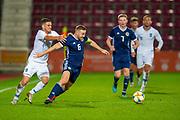 Alexandros Katranis (#3) of Greece U21 pulls back Allan Campbell (#6) of Scotland U21 (Motherwell) during the U21 UEFA EUROPEAN CHAMPIONSHIPS match between U21 Scotland and U21 Greece at Tynecastle Park, Edinburgh, Scotland on 15 November 2019.