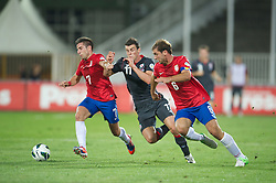 NOVI SAD, SERBIA - Tuesday, September 11, 2012: Wales' Gareth Bale in action against Serbia's Zoran Tosic and captain Branislav Ivanovic during the 2014 FIFA World Cup Brazil Qualifying Group A match at the Karadorde Stadium. (Pic by David Rawcliffe/Propaganda)