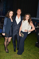 Left to right, SHIRLEY LEIGH WOOD-OAKES, JOHN DORRANCE and NATASHA CORRETT at the Battersea Power Station Annual Party at Battersea Power Station, 188 Kirtling Street, London SW8 on 30th April 2014.