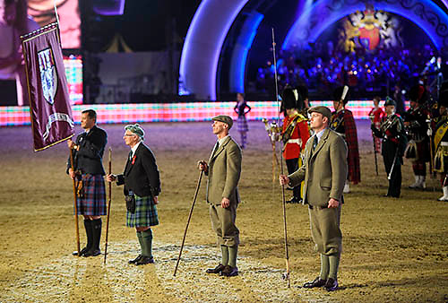 © Licensed to London News Pictures. 15/05/2016. Windsor, UK.  Men dresses in Scottish themed costume. An evening event held at the Royal Windsor Horse show to celebrate the 90th birthday of HRH Queen Elizabeth II. Acts from arounds the world have been invited to perform at the evening event, set in the grounds of Windsor Castle. Photo credit: Ben Cawthra/LNP
