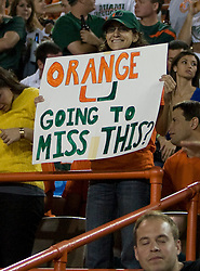 """A Miami fan holds up a sign that reads """"Orange U Going to Miss This?"""" during the final UM football game at the 70 year old Orange Bowl.  The #19 Virginia Cavaliers defeated the Miami Hurricanes 48-0 at the Orange Bowl in Miami, Florida on November 10, 2007.  The game was the final game played in the Orange Bowl."""