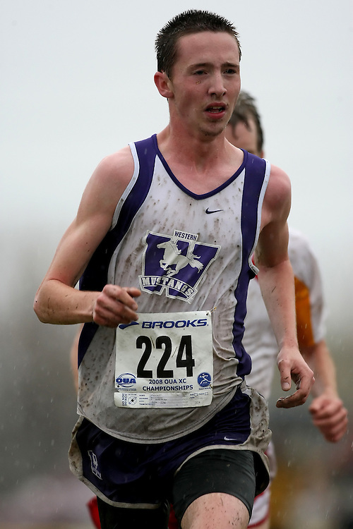(Kingston, ON---25 October 2008) Kyle O'Neill of WESTERN ONTARIO University running to finish 3 in the 2008 Ontario University Athletics men's cross country championship.  Photograph copyright Sean Burges/Mundo Sport Images (www.msievents.com).