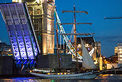 © Licensed to London News Pictures. 09/04/2014. Tall ship JR TOLKIEN passes under Tower Bridge. The tall ship is in London to preview this summer's tall ships regatta. Taken 8th April Credit : Rob Powell/LNP
